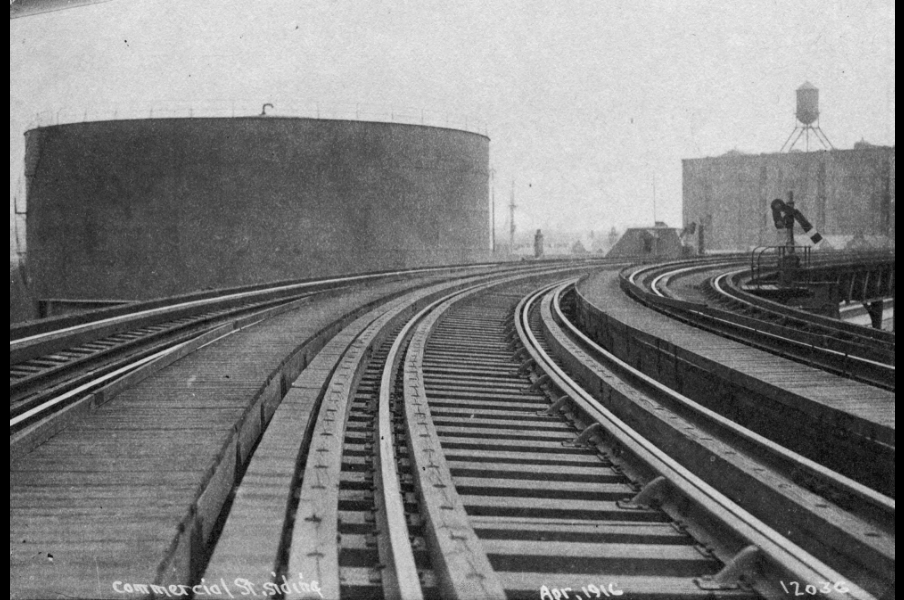 Image for molasses tank viewed from elevated railroad (1916, ber photograph collection, 9800 018, boston city archives)