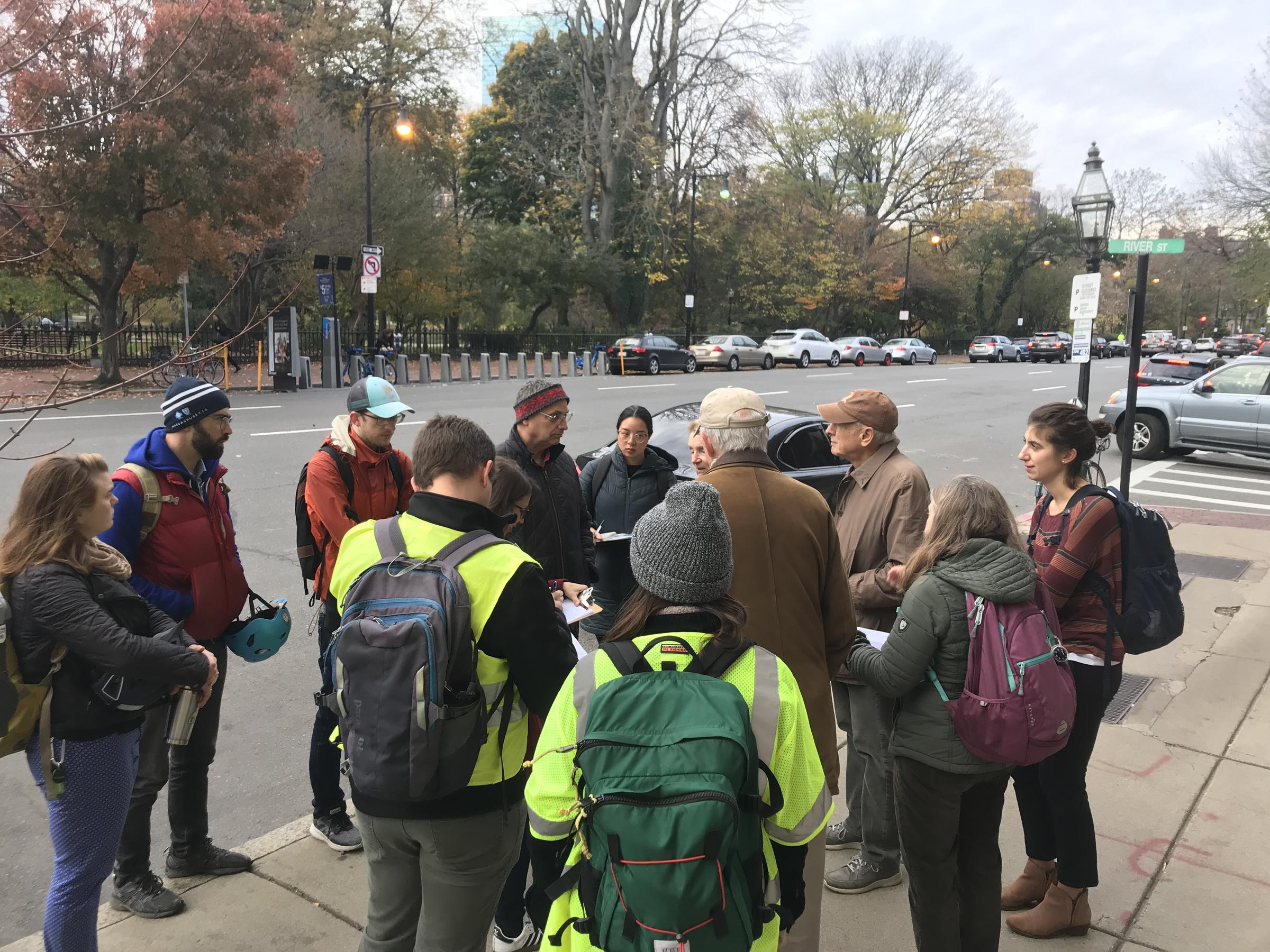 Photo showing participants in the Back Bay Community Walk; about 15 people gathered in a group on a sidewalk.