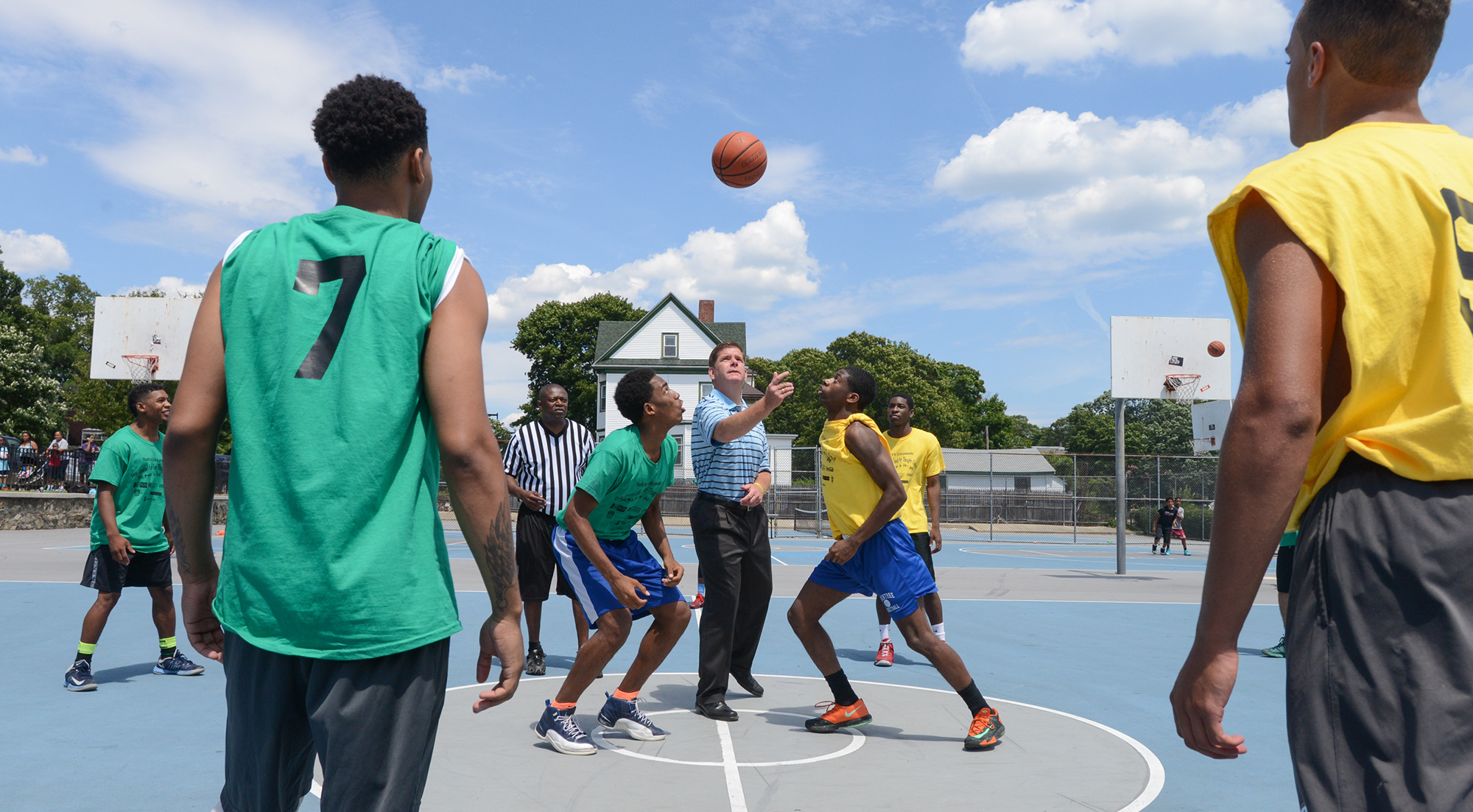 Image for mayor walsh throws the opening tip off for the 2014 youth in crisis scoops for hoops event in mattapan