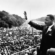 Image of Rev. Dr. Martin Luther King, Jr. waving to crowd
