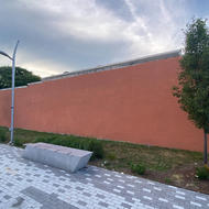 Orange Wall adjacent to plaza at Grove Hall municipal parking lot