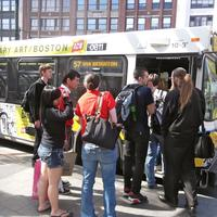 Image for people getting on mbta bus 57